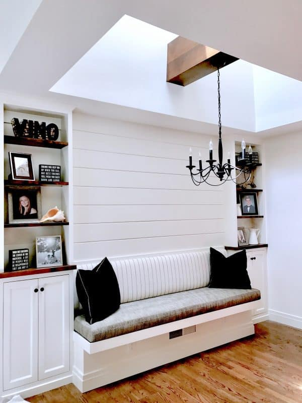black and white banquette flanked by shelves