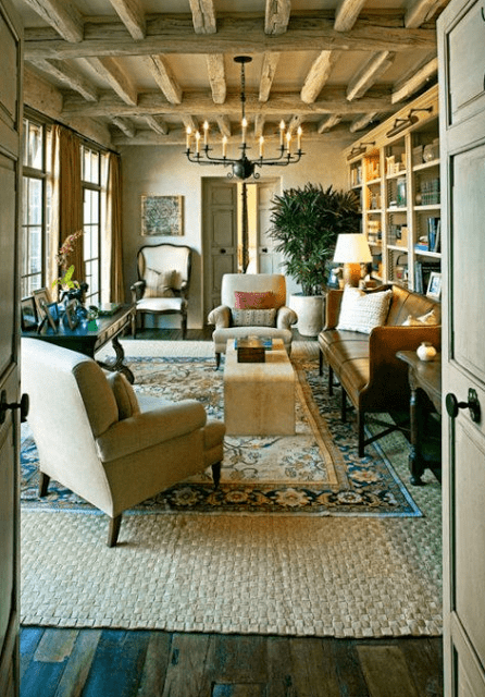 IS YOUR RUG TOO SMALL? Layering and Large Neutral Area Rugs