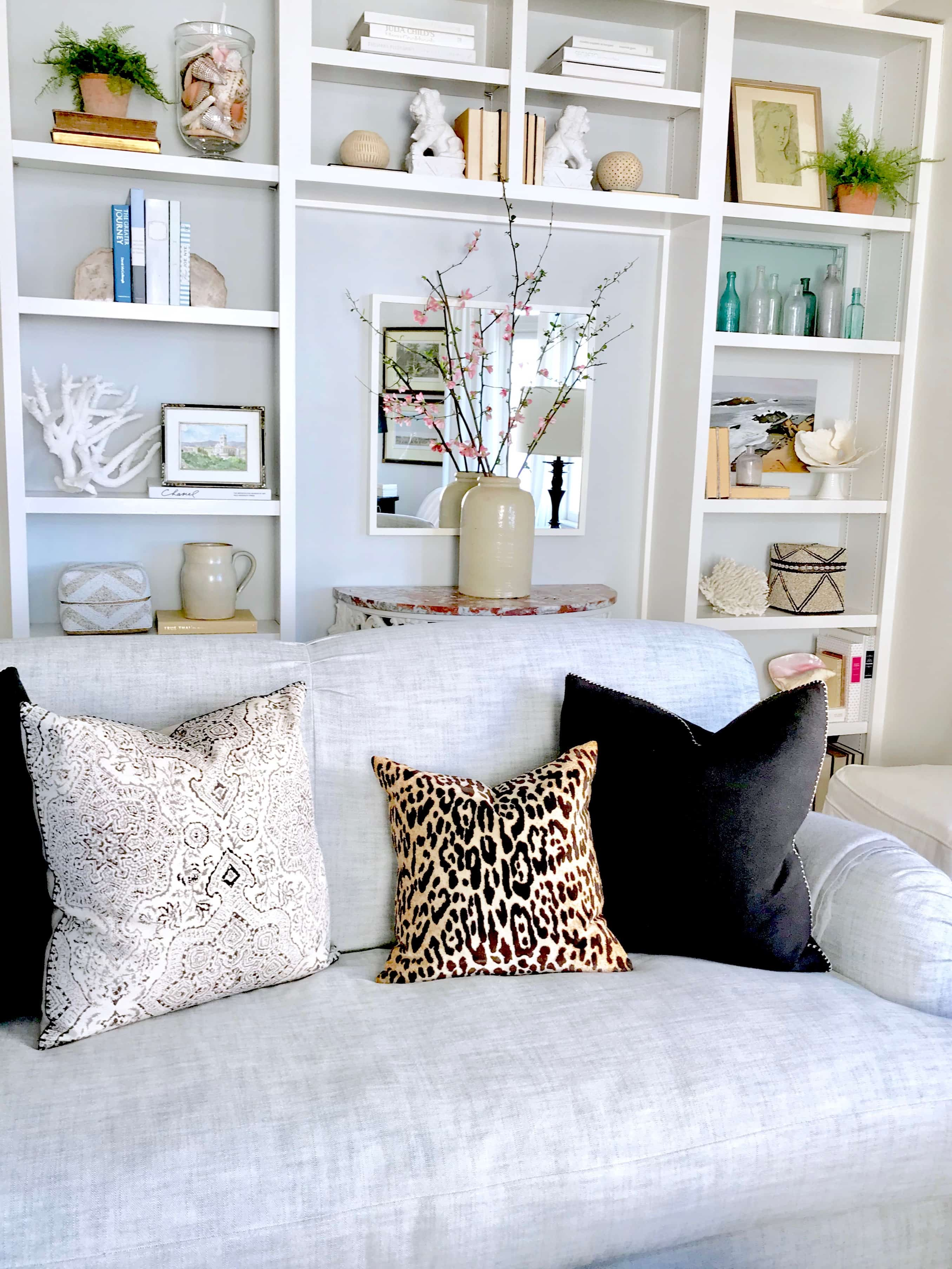 Living Room with pillows and styled shelves - Classic Casual Home