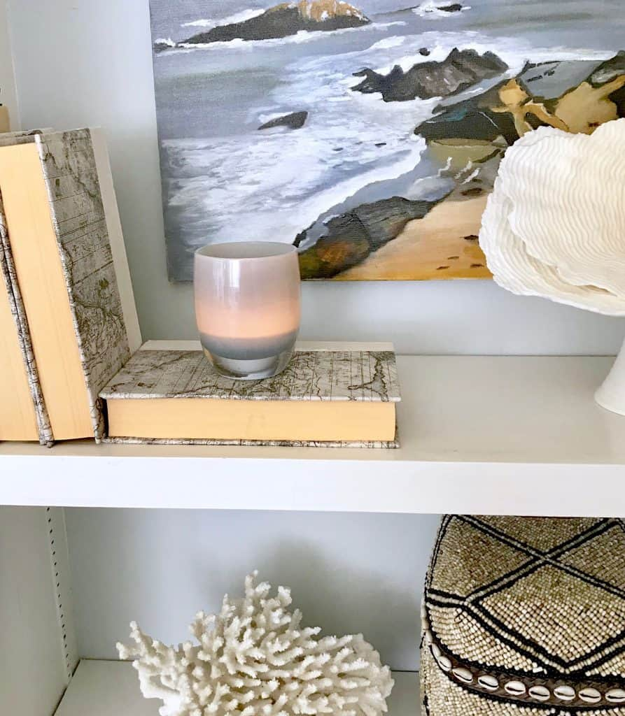 Shelf styling with art and Glassy Baby