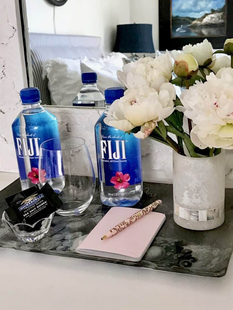 guest room touches like fiji water and chocolates