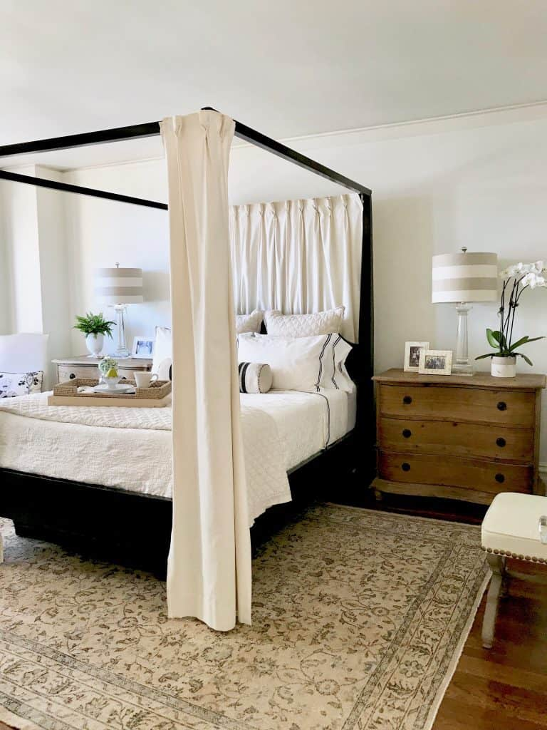 black four poster bed and vintage Turkish rug