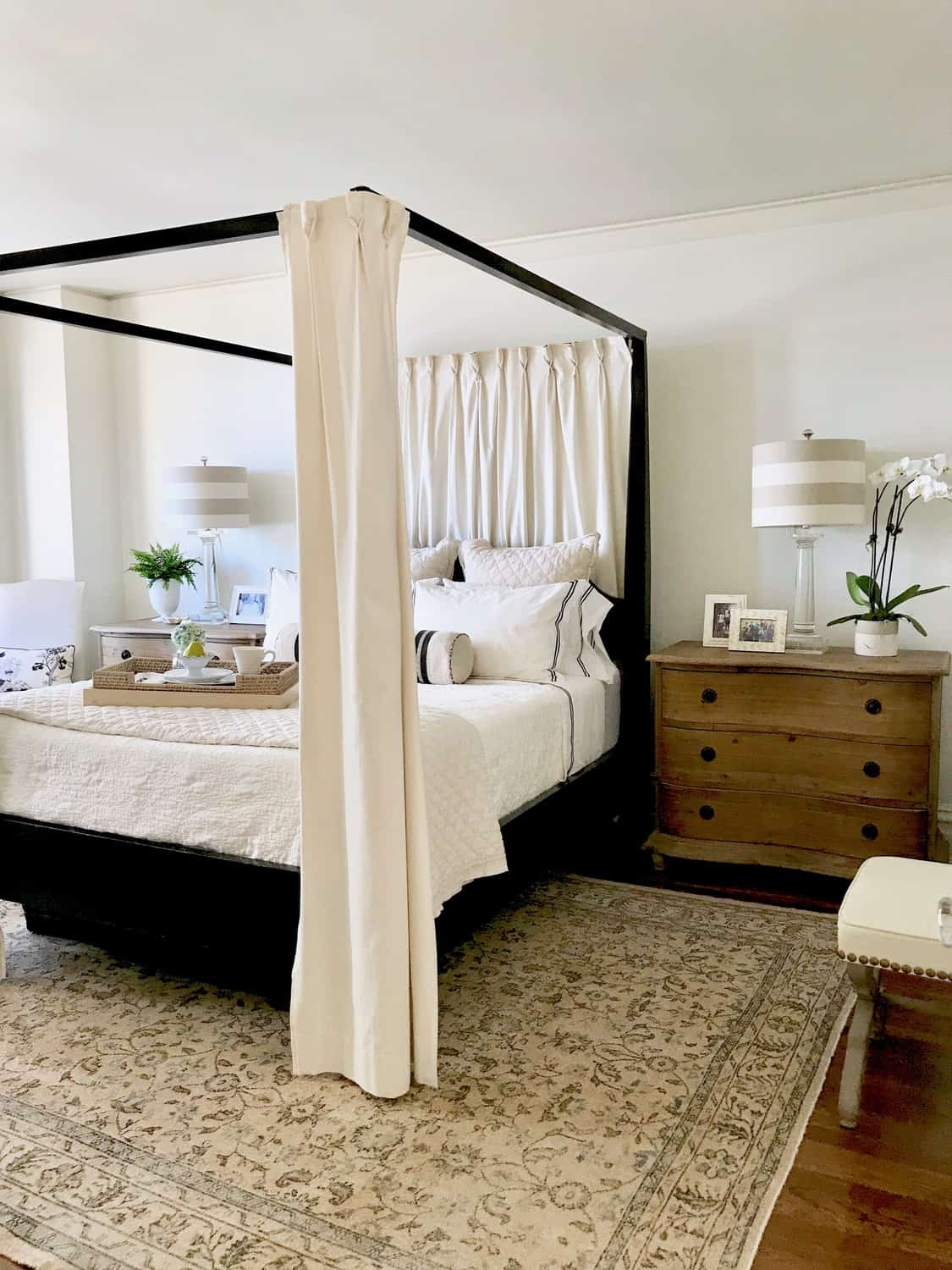 Black four poster bed with pine chests and breakfast tray - Classic ...