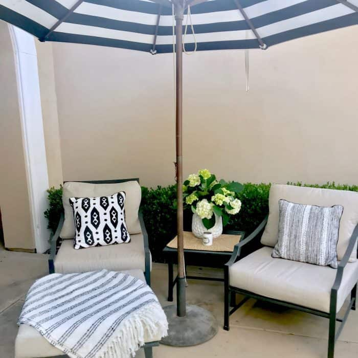 Black and white striped umbrella and Target pillows