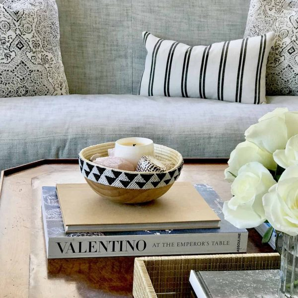 Black and White wooden bowl and pillows, coffee table styling