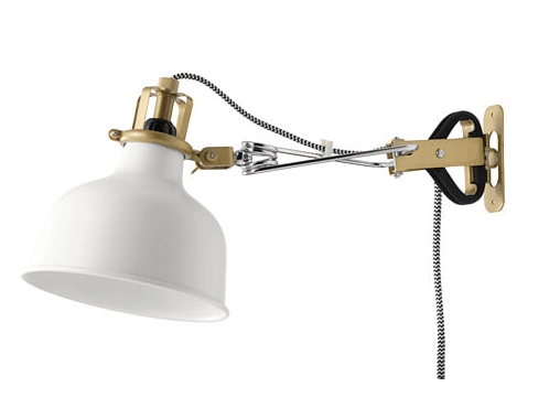 IKEA white clip lights to illuminate bookcases Boho apartment