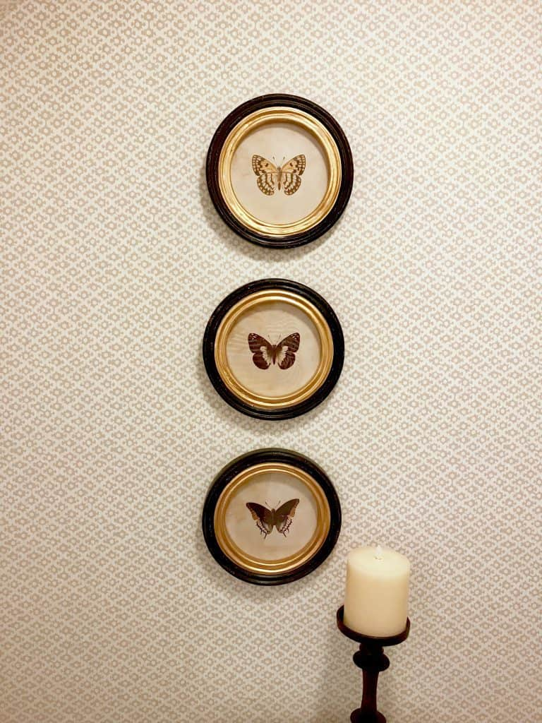 Vintage butterfly art over toilet