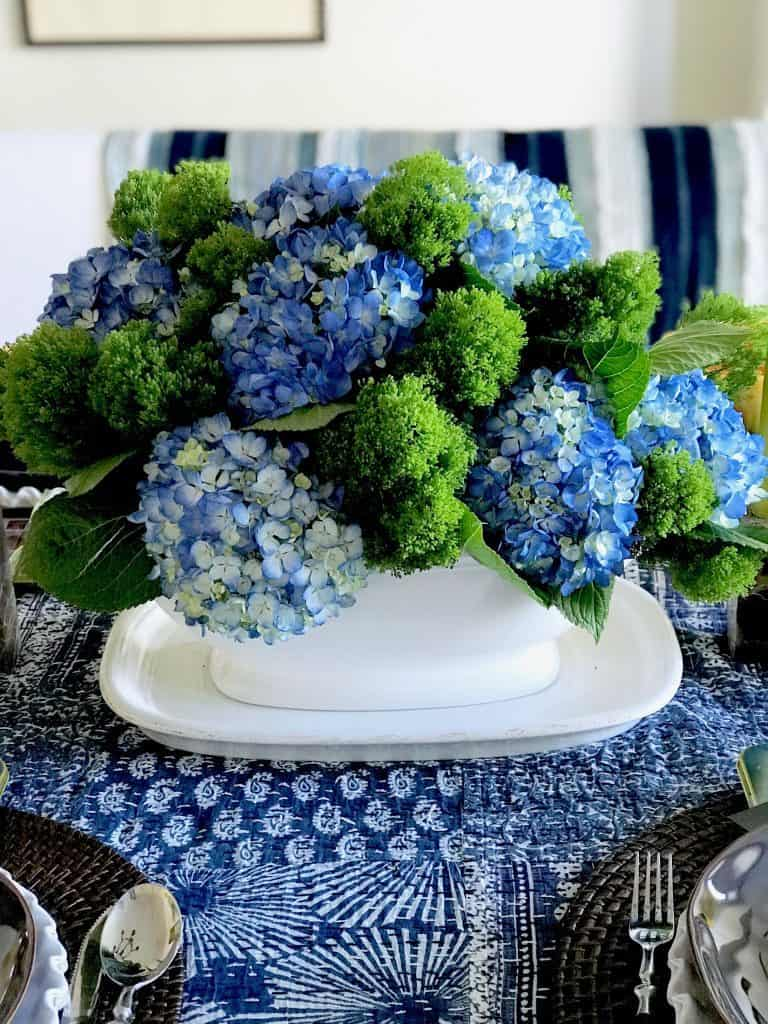 Blue and green hydrangeas in white soup tureen