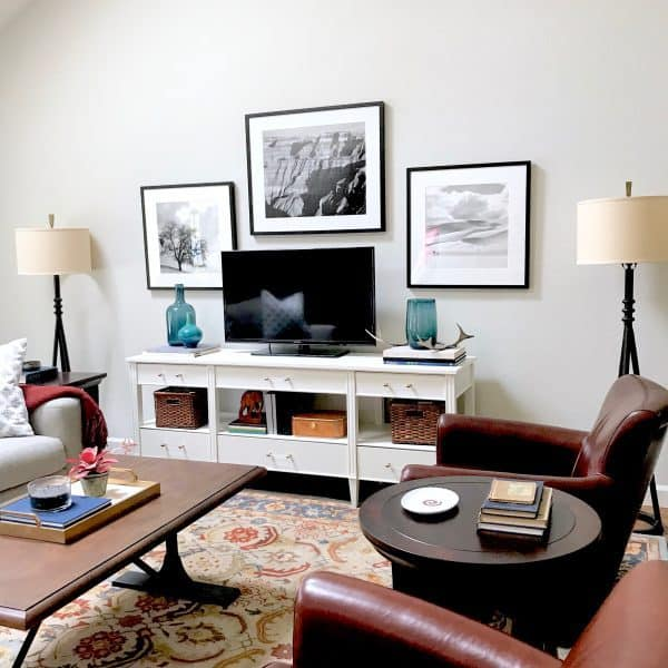 Black and white Minted art with Pottery Barn leather chairs