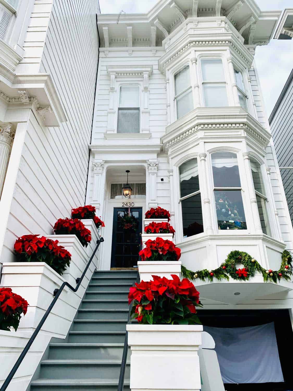 White Victorian with red Poinsettias