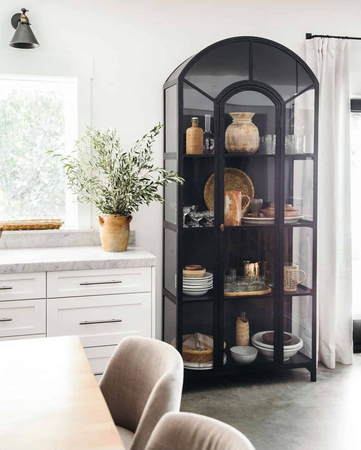 Glass cabinet with vintage dishes