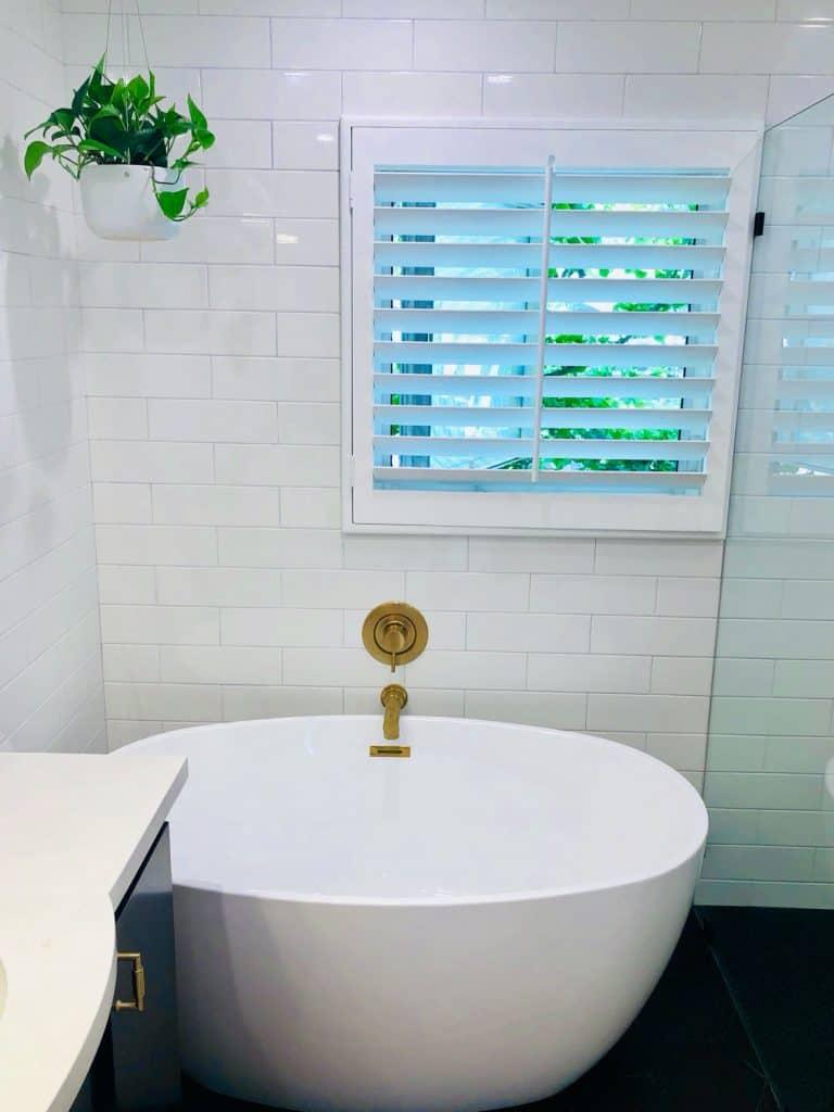 soaking tub in black and white bathroom remodel