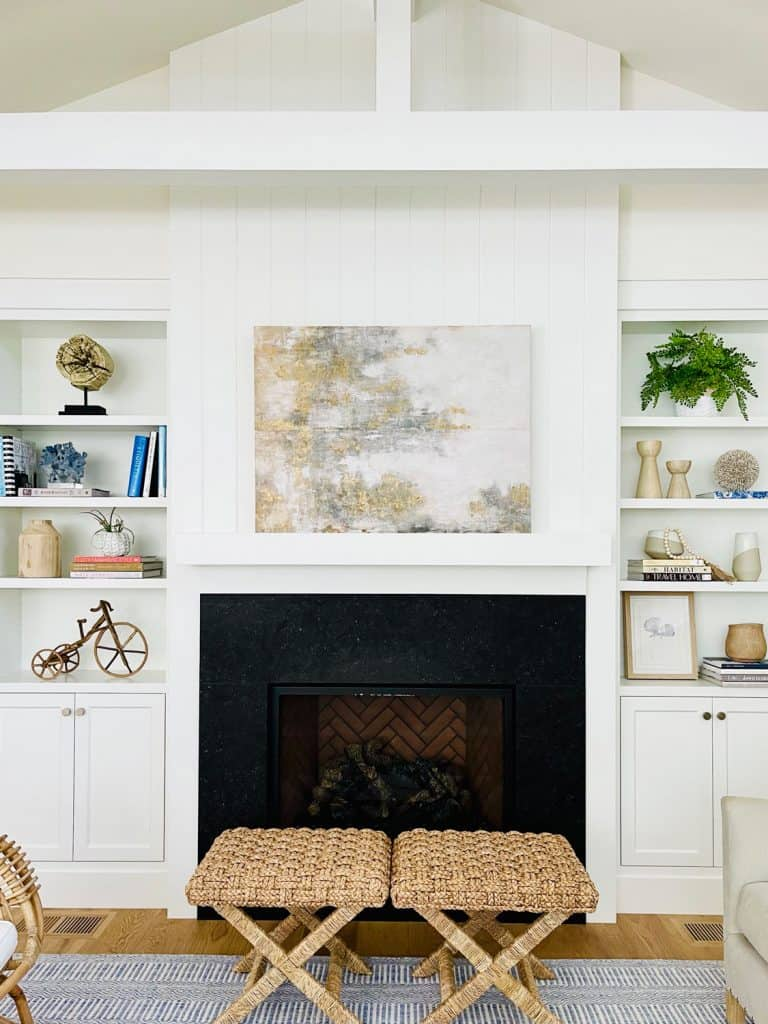 White bookcase with black fireplace and modern landscape