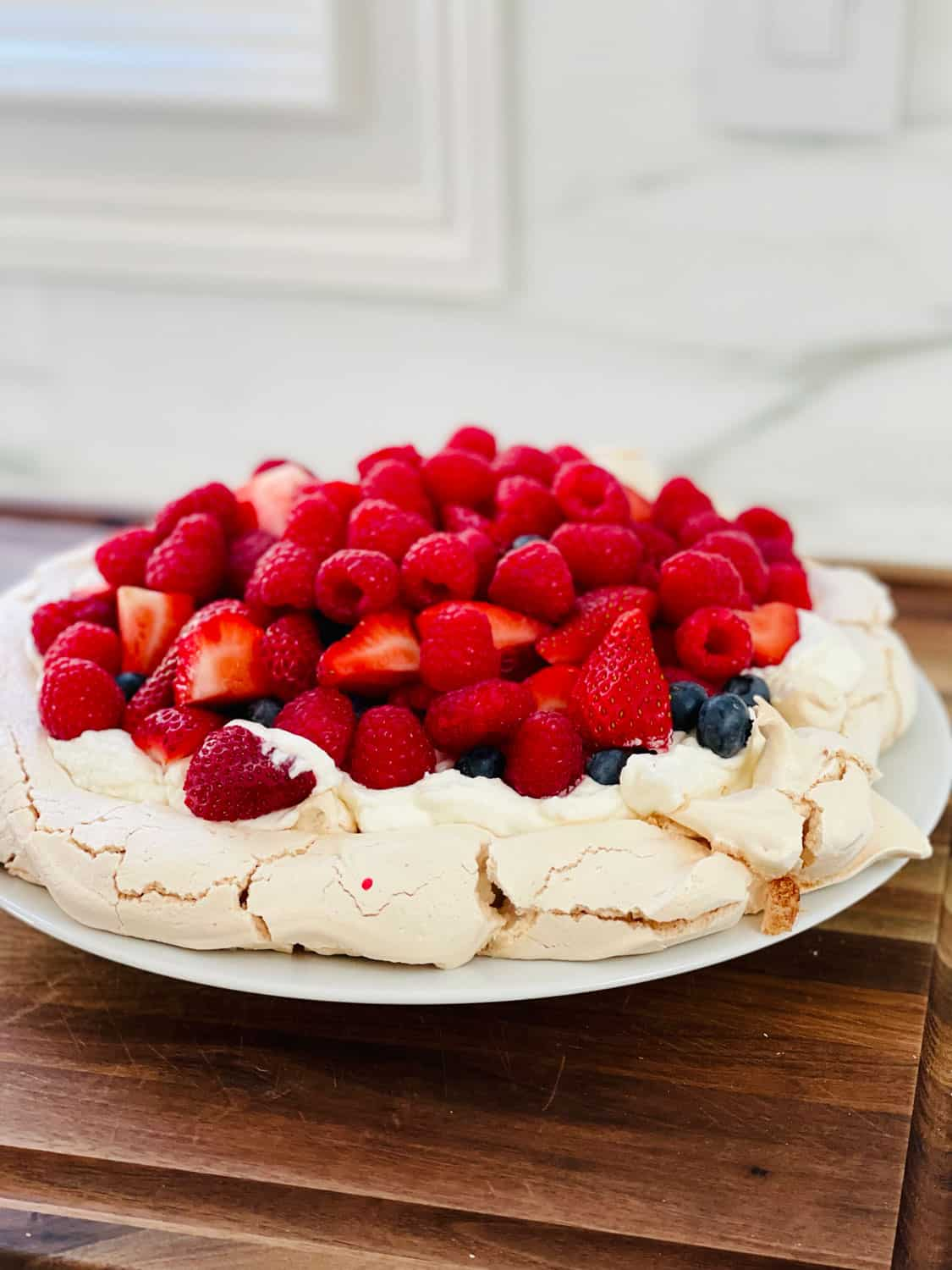 egg white dessert with mixed berries