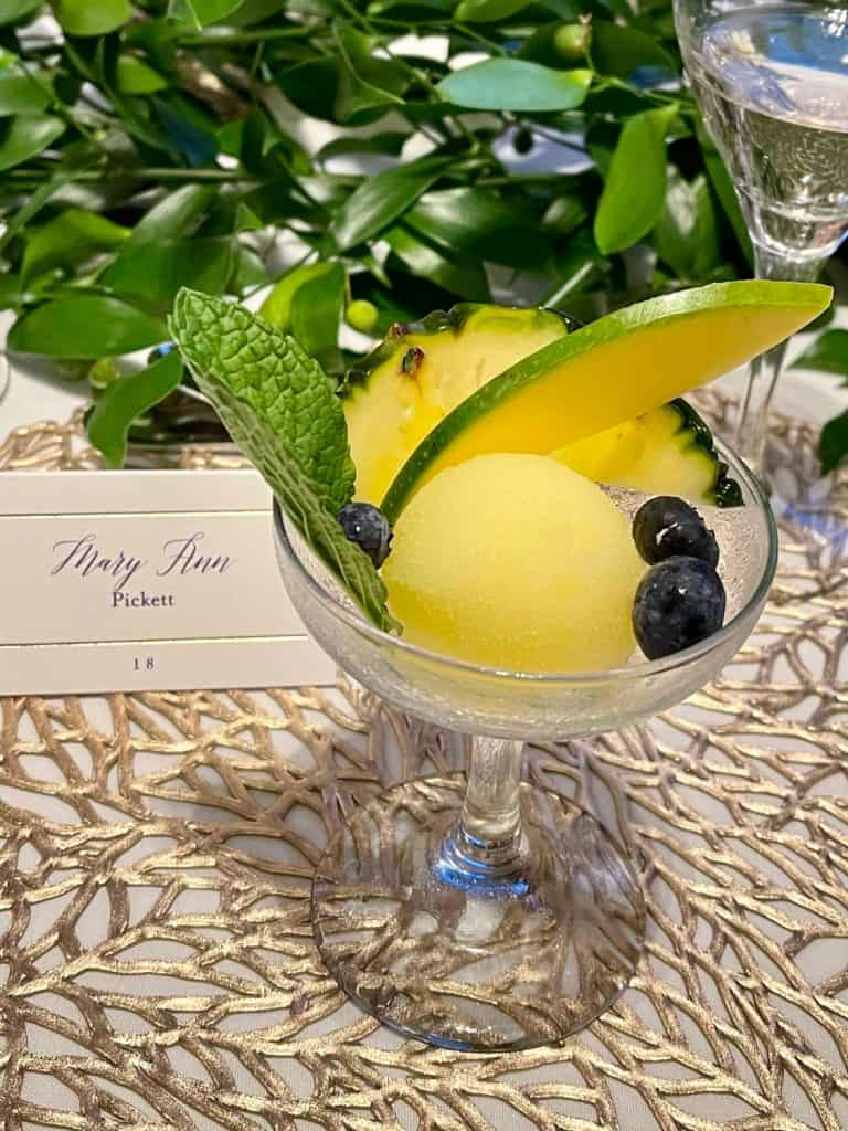 lemon sorbet with pear and blue berry garnish