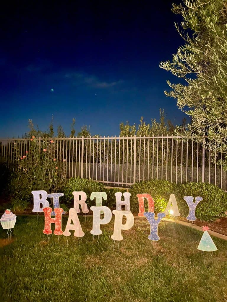 Happy birthday lettered yard sign