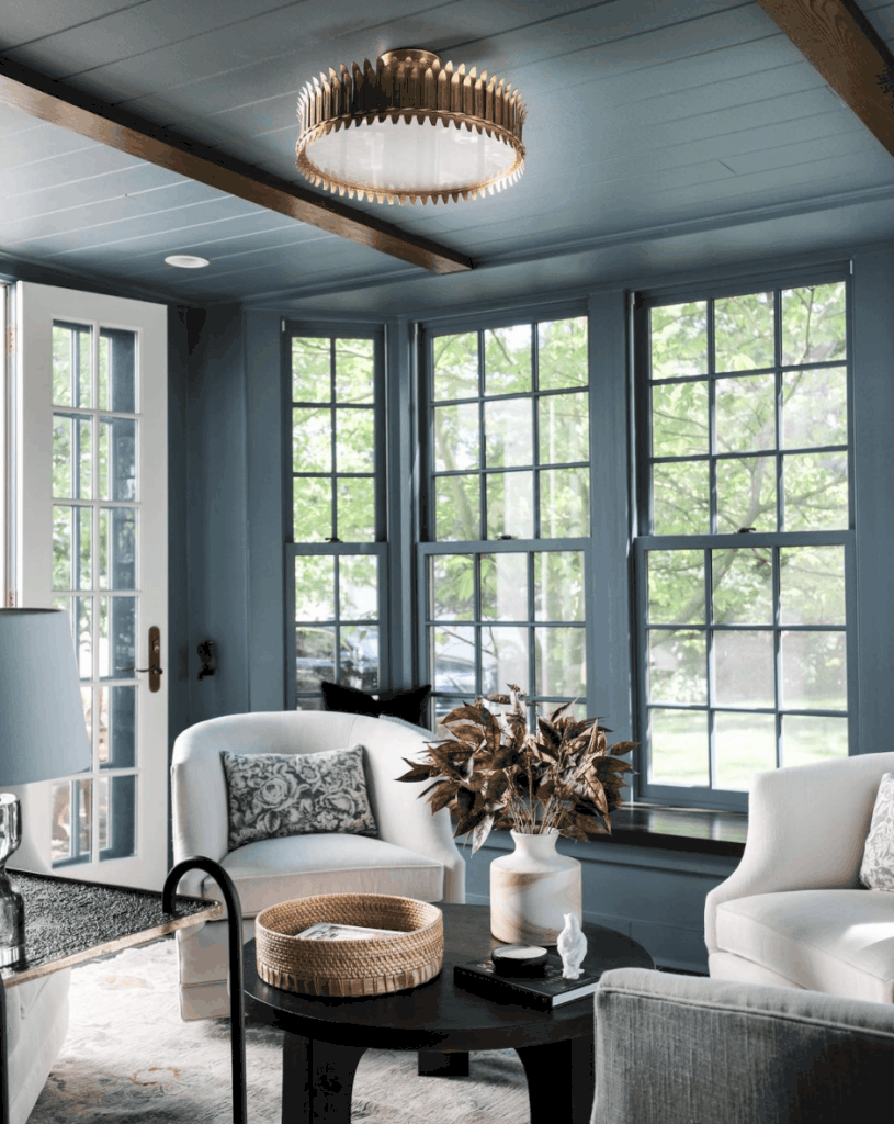 Cozy Sitting Area with window trim and walls the same color